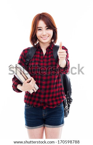 Young happy Asian student show thumb isolated on white.