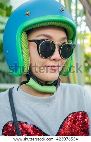 Young happy Asian woman wearing helmet biker. - stock photo