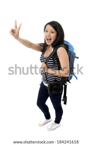young happy attractive asian chinese tourist woman carrying heavy backpack and passport ready for adventure and vacations doing okay sign with her hand isolated on white background - stock photo