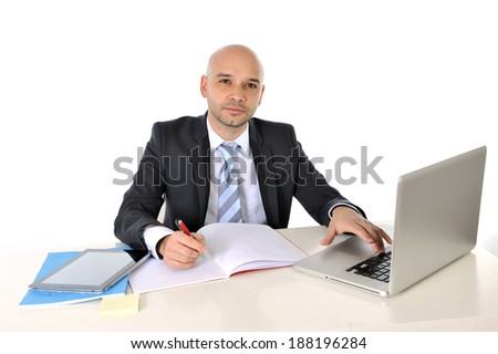 young happy attractive bald business man working with computer posing relaxed at office desk in success and efficiency concept