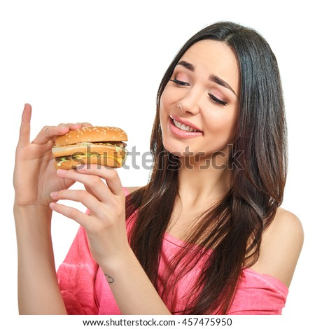 Young happy attractive woman with fast food. Unhealthy eating. - stock photo