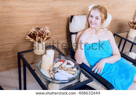 Young happy beautiful girl in spa salon relaxing in the relaxation room. beauty portrait - stock photo