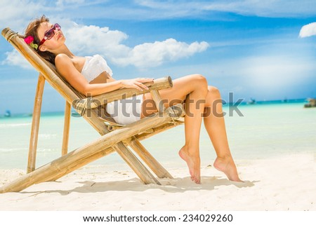 young happy beautiful woman outdoor portrait, tropical sand beach and sky background - stock photo