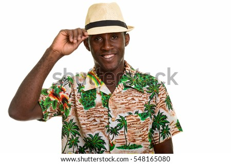 Young happy black African man smiling while holding hat isolated against white background