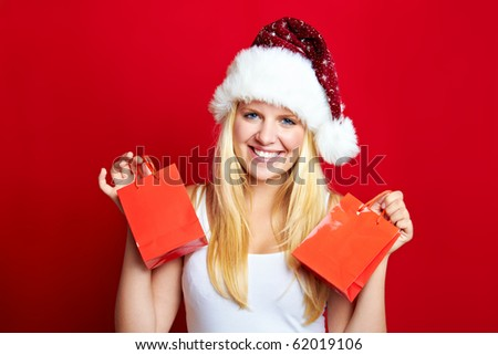 young happy blond christmas woman with gifts - stock photo