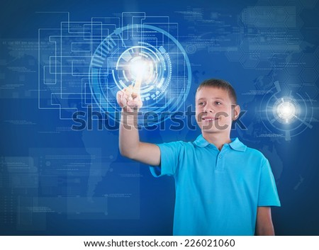young happy boy working with digital virtual screen - stock photo