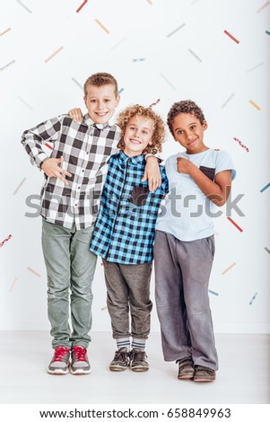 Young happy boys hugging and smiling in the photo