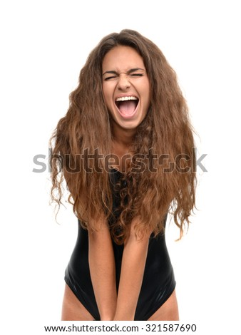 Young happy brunette beautiful sexy woman posing laughing out loud smiling isolated on a blue background