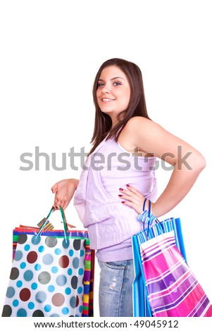 young happy brunette girl standing very satisfied with shopping paper bags