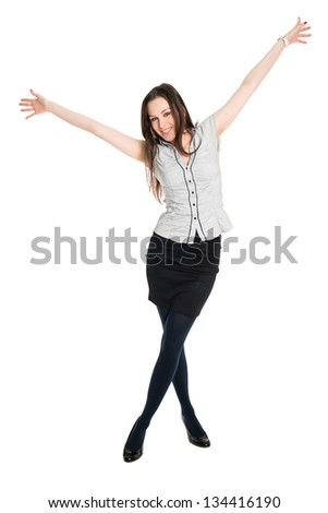 Young happy brunette with hands up, celebrating victory. Isolated on white background
