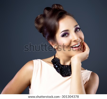 young happy brunette woman with beautiful makeup and hair - stock photo