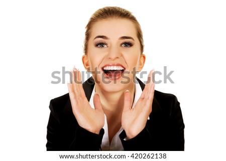 Young happy buisnesswoman screaming. - stock photo