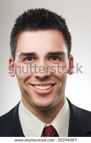 Young happy business man close up portrait