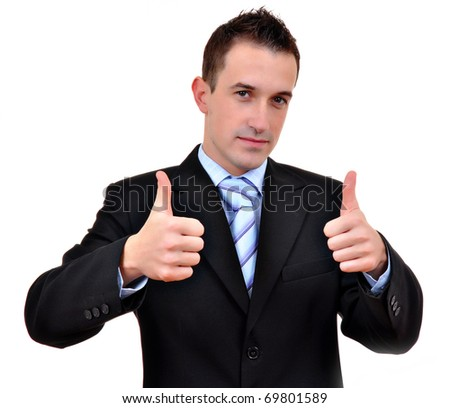 Young happy business man going thumbs up, isolated on white - stock photo