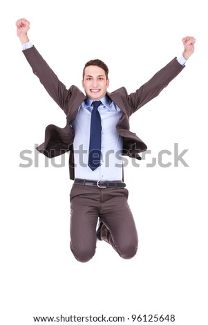 Young happy  business man jumping in the air , isolated on white background - stock photo