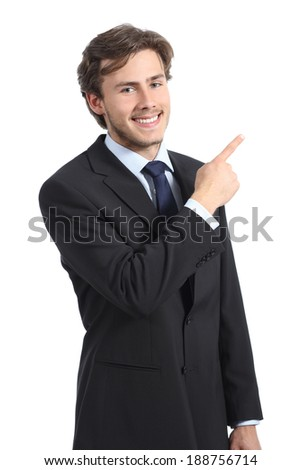 Young happy business man pointing at side isolated on a white background
