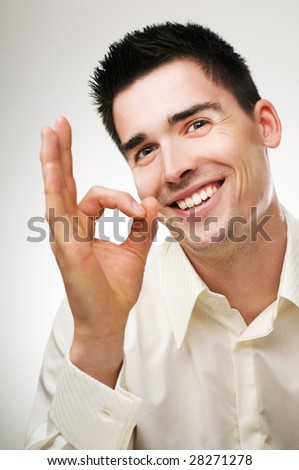 young happy business men showing ok sign - stock photo