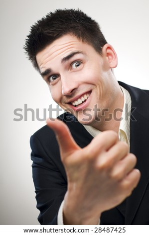 young happy business men showing thumb up - stock photo
