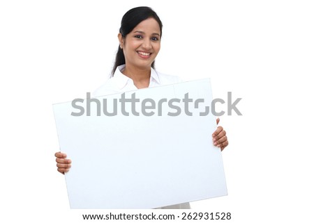 Young happy business woman holding blank signboard - stock photo