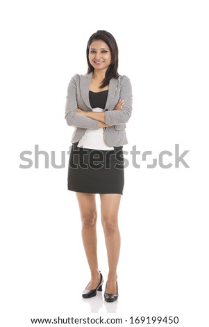 Young happy business woman, isolated on white.
