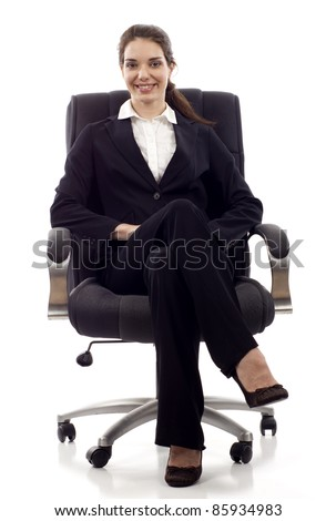 Young happy business woman sitting on a chair isolated on white - stock photo