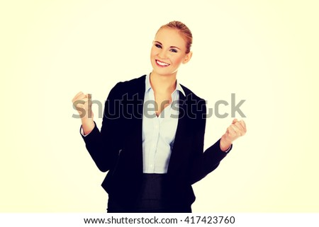Young happy business woman with arms up - stock photo