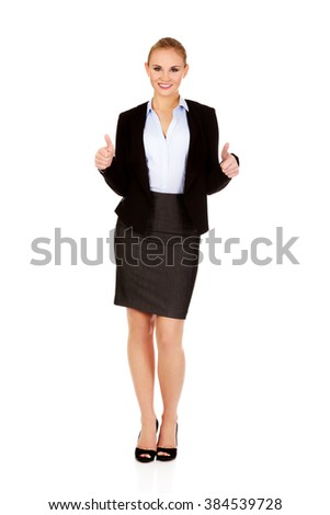 Young happy business woman with thumbs up - stock photo