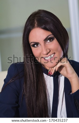 Young happy business woman working at office