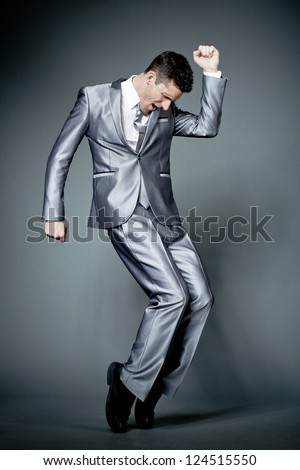 Young happy businessman in gray suit. - stock photo