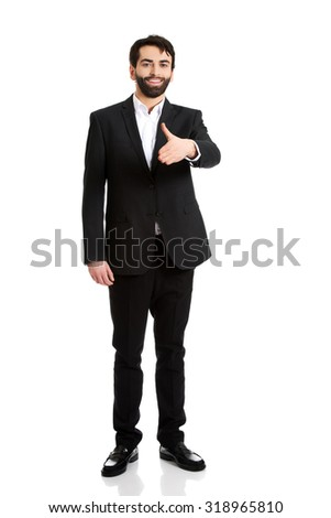 Young happy businessman offering a handshake.