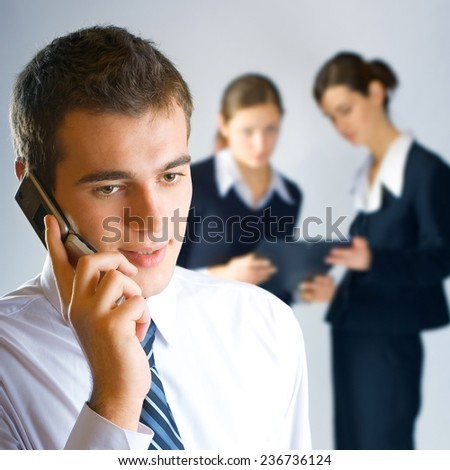 Young happy businesspeople working together at office - stock photo