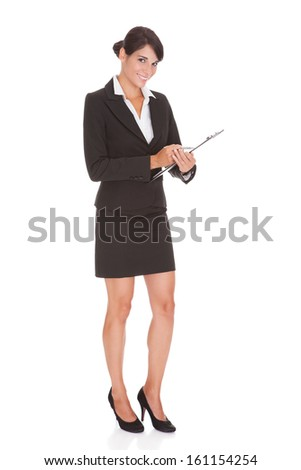 Young Happy Businesswoman Holding Clipboard Over White Background - stock photo