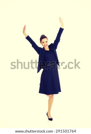 Young happy businesswoman with hands up.