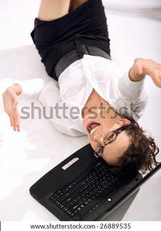Young happy businesswoman with notebook rolling on the floor