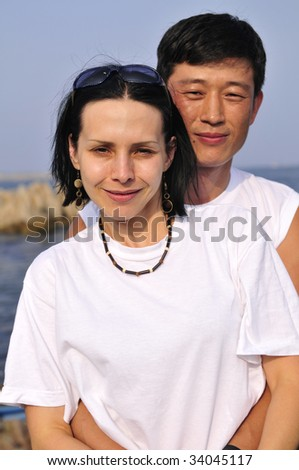 Young happy casual couple outdoor - stock photo