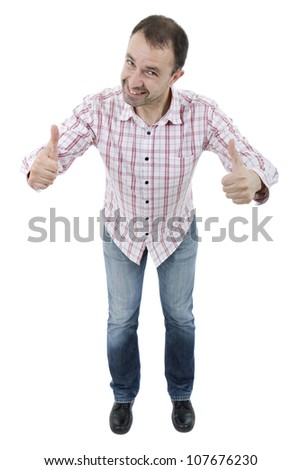 young happy casual man, full body, going thumb up, isolated - stock photo