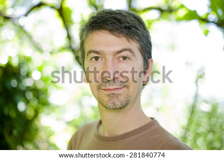 young happy casual man portrait, outdoors, bokeh picture - stock photo