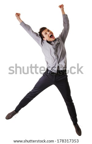 Young happy caucasian businessman or student jumping in the air , isolated on white background