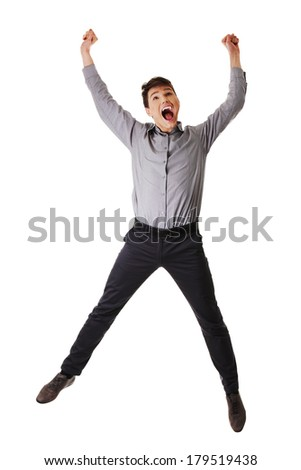 Young happy caucasian businessman or student jumping in the air , isolated on white background  - stock photo