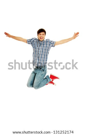 Young happy caucasian man jumping in the air , isolated on white background - stock photo