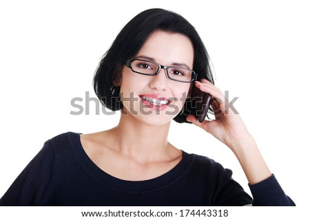 Young happy caucasian woman is calling with a mobile phone (smartphone) isolated on white