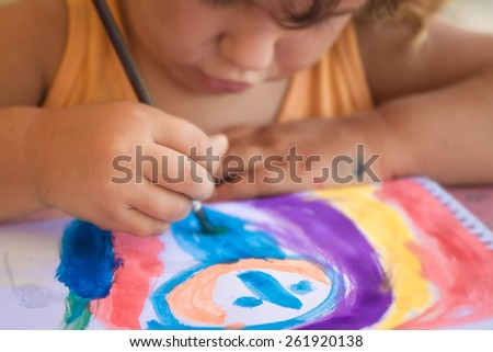 young happy child girl painting - stock photo