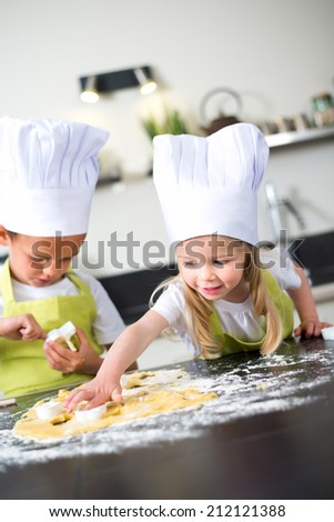 young happy children kids family preparing funny cake in kitchen at home - stock photo