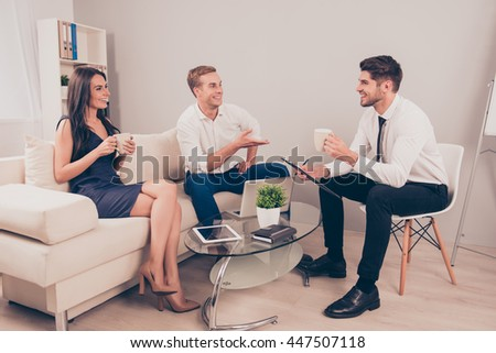 Young happy colleagues having free time and drinking coffee - stock photo