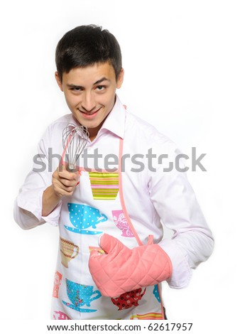 Young happy cook man in apron smiling, holding tool for baking. isolated on white background