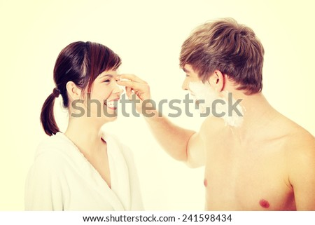 Young happy couple at bathroom - stock photo