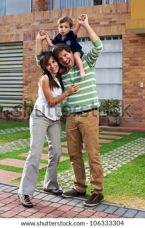 Young happy couple at their new big house - stock photo