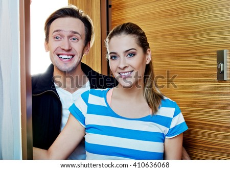 Young happy couple coming back to home - stock photo