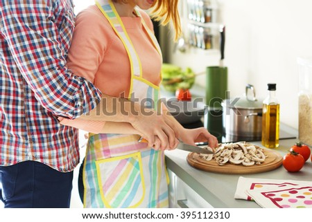 Young happy couple cooking together, close up