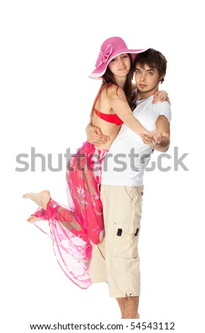 young happy couple dancing in their beach clothes isolated on white - stock photo